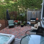 patio interlock red brick with hot tub