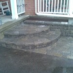 Front interlocking grey stone with garden