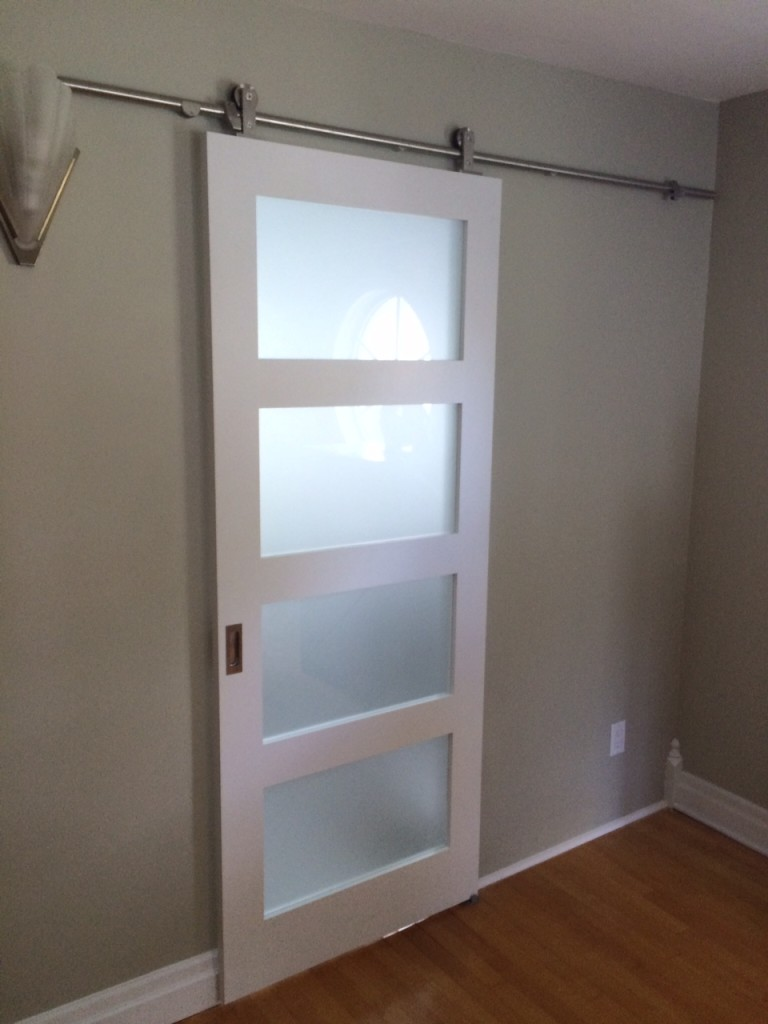 Modern 4 panel barn door on roller