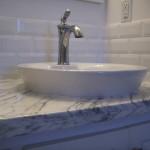 White bathroom tile backsplash