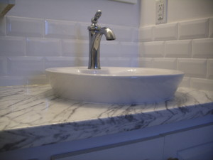 White bathroom tile backsplash