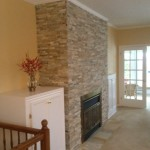 decorative stone installed on fireplace wall
