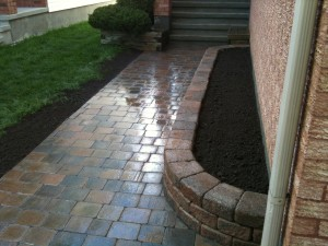 Red stone interlock walk way with side garden