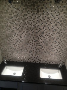 glass tile backsplash in bathroom